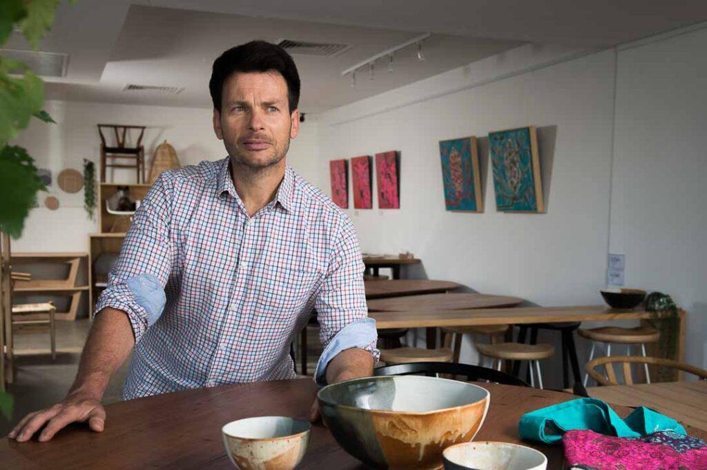 Portrait of Christian at his Melbourne business, OZ Tables